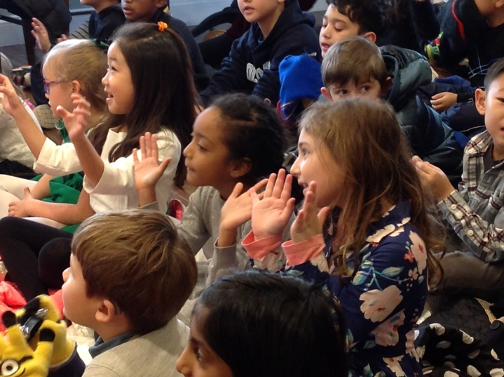 Students clap for our spelling bee winners!